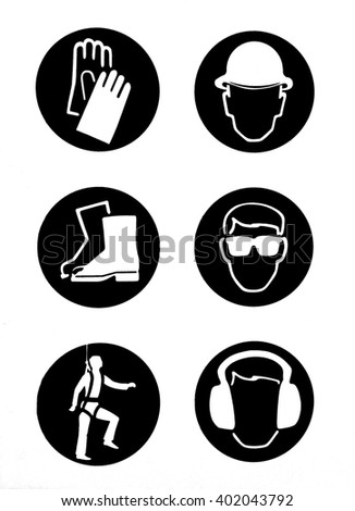 These are symbols used in a construction site. Clockwise direction: safety helmet, safety goggles, safety ear muffs, safety harness, safety boots and anti-cut safety gloves protect workers from hurt. - stock photo