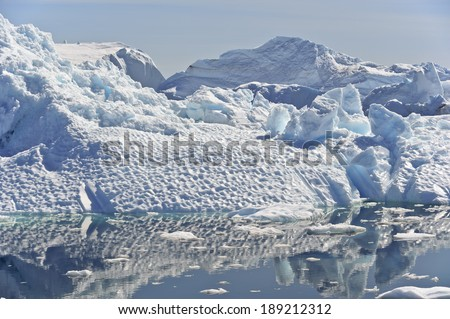 These icebergs are calved by the Jakobshavn glacier, and may stay in the icefjord for years, before floating North with the currents, eventually turning south and down into the Atlantic. I - stock photo