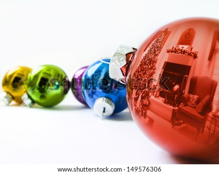 These shiny Christmas Ornaments reflect the Holiday Season of this decorated living room with  Christmas Tree and holiday decorations - stock photo