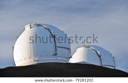 These Telescope domes are found on the astronmy complex on top of Mauna Kea on the big Island of Hawaii - stock photo