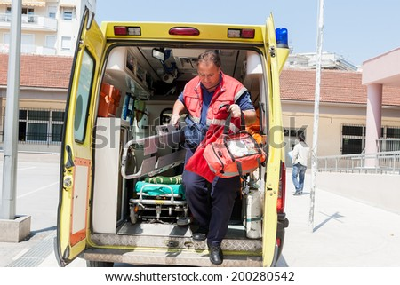 THESSALONIKI, GREECE- APRIL 24, 2013: Paramedic carrying equipment to assist injured people during an earthquake exercise at 6th primary school in Thessaloniki, Greece. - stock photo