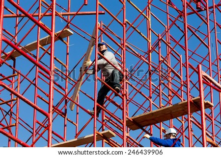 THESSALONIKI, GREECE - JANUARY 15, 2015: Unidentified workers setting up iron scaffolding at construction area