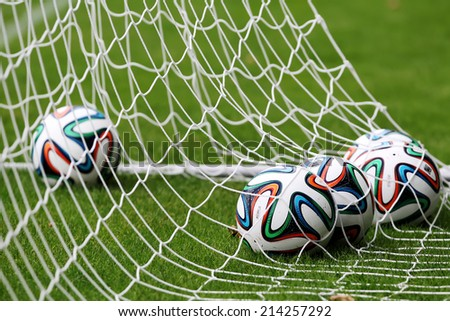 THESSALONIKI, GREECE - JULY 20, 2014: Greek Superleague Brazuca (Mundial) balls in net during Paok training in Thessaloniki, Greece.