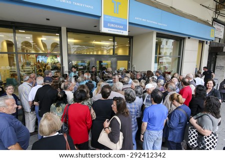 THESSALONIKI, GREECE, JULY, 1 2015: Pensioners queue outside a National Bank branch as banks only opened for the retired to allow them to cash up to 120 euros in Athens - stock photo