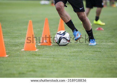 Thessaloniki, Greece- June 2, 2015: Players of Paok training for better shape, in Thessaloniki, Greece. - stock photo