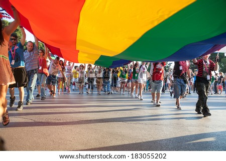 THESSALONIKI, GREECE - JUNE 15: Unidentified participants taking part to the second gay pride parade through the city on June 15, 2013 in Thessaloniki, Greece.  - stock photo