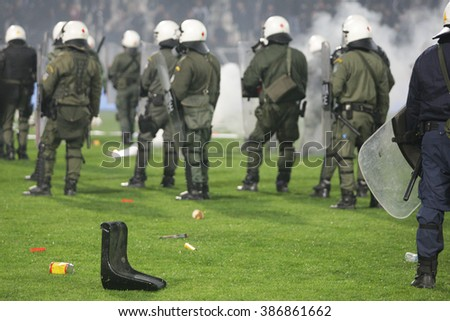 THESSALONIKI, GREECE - MARCH 02, 2016: Clashes among PAOK fans and riot police during the semifinal Greek Cup game between PAOK and Olympiacos played at Toumba stadium - stock photo