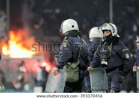 Thessaloniki, Greece - March 02, 2016: PAOK fans clash with riot police during the semifinal Greek Cup game between PAOK and Olympiacos played at Toumba stadium