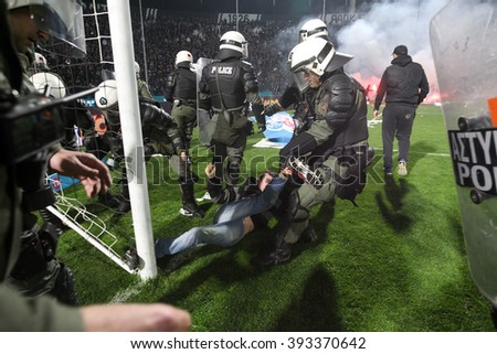 Thessaloniki, Greece - March 02, 2016: PAOK fans getting arrested after clashing with riot police during the semifinal Greek Cup game between PAOK and Olympiacos played at Toumba stadium - stock photo