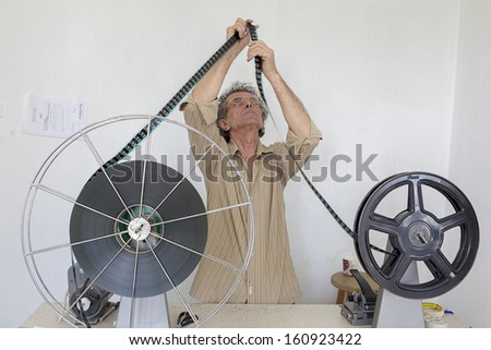 THESSALONIKI,GREECE - NOV 5:Old motion picture film reel during the TIFF on November 5, 2012. This festival is among the top film festivals of Europe and the oldest in the Balkans. - stock photo