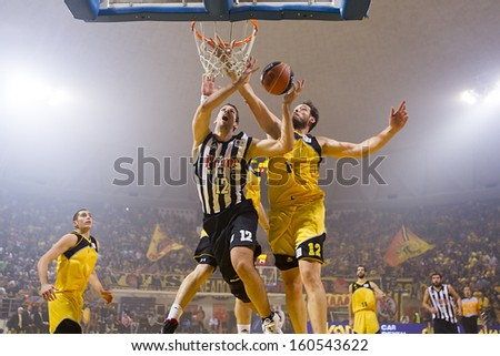 THESSALONIKI, GREECE - OCT 19 : Kalles of Paok (L) in action with Harisis of Aris (R) during the Greek Basket League game Aris vs Paok in Alexandreio Melathron on October 19, 2013 Thessaloniki, Greece - stock photo
