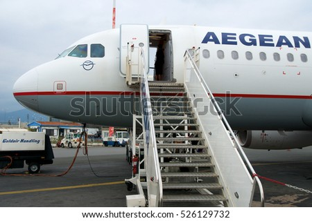 THESSALONIKI, GREECE - OCTOBER 16th, 2016: Boarding an airplane at the airport field or apron of airfield.
