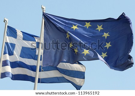 THESSALONIKI,GREECE - SEPT 4: European Union flag and Greek flag, waving in the wind on September 4, 2012 in Thessaloniki, Greece - stock photo