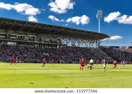 THESSALONIKI, GREECE, -SEPT 22 : Panoramic view of the full Toumba Stadium in the early evening during the Superleague match Paok vs Platanias on September 22, 2013 in Thessaloniki, Greece. - stock photo