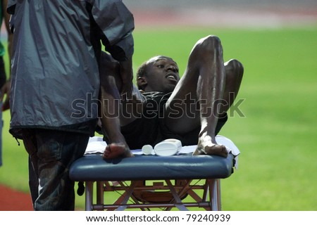 THESSALONIKI, GREECE -SEPTEMBER 11:Jamaican U.Bolt stretching in the training center for the IAAF World Athletics Finals main event in Kaftatzoglio Stadium on September 11, 2009 in Thessaloniki,Greece - stock photo
