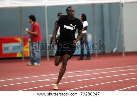 THESSALONIKI, GREECE -SEPTEMBER 11:Jamaican U. Bolt warming up in the training center for the IAAF World Athletics Finals main event in Kaftatzoglio Stadium on September 11,2009 in Thessaloniki,Greece - stock photo