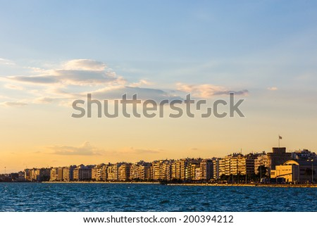Thessaloniki seafront and city in the afternoon against a cloudy sky - stock photo