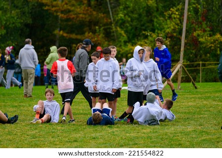 THETFORD CENTER, VT, USA - OCTOBER 4, 2014: Middle school boys warming up for the start of the 24th annual Thetford Academy Woods Trail Run, middle school boys division.