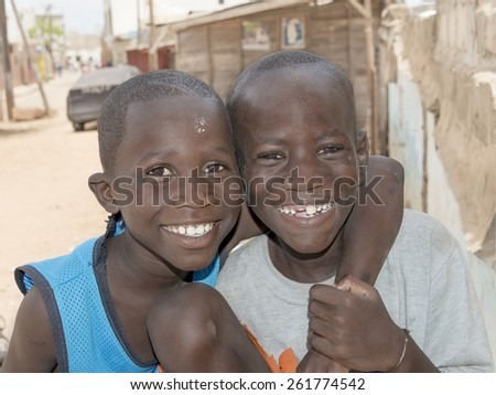 Thiaroye, Senegal, August 2, 2014, Two unidentified boys standing in the street, popular district of Guinaw Rails - stock photo