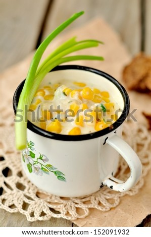 Thick and creamy corn chowder with potatoes and greens - stock photo