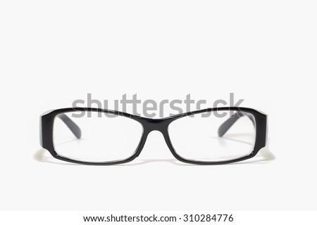 Thick black glasses on white background - stock photo