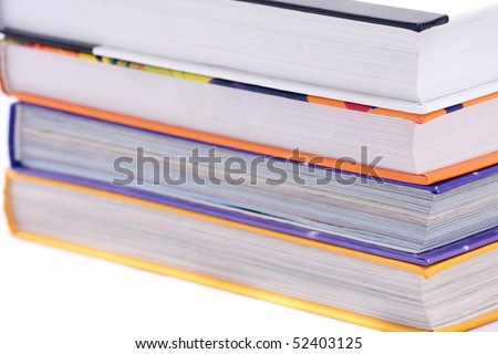 Thick books on white background - stock photo