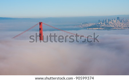 Thick fog covering Golden Gate Bridge - stock photo