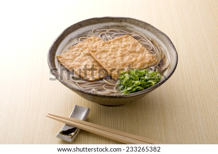 thick fried tofu on delisious buckweat noodles - stock photo