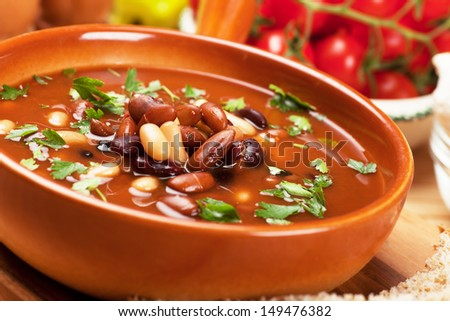 Thick kidney bean soup in rustic bowl, selective focus image - stock photo