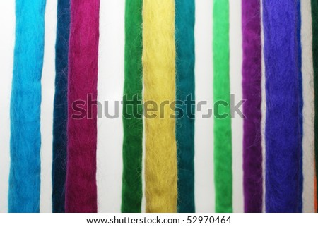 thick multicolored threads strained in the loom
