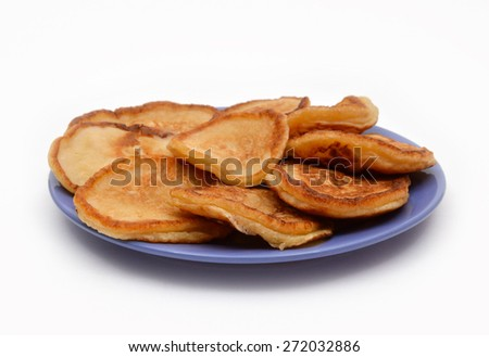 Thick pancakes on the lilac plate.