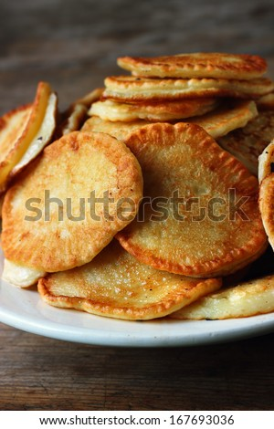Thick pancakes on wooden background