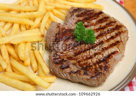 Thick rump beef steak with french fries