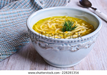 Thick soup with pasta, vegetables and dill - stock photo