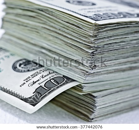 thick stack of hundred dollar bills closeup