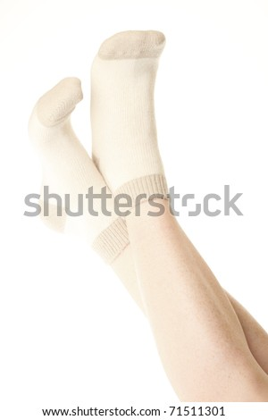 thick woollen socks on the foot relax isolated on white background - stock photo