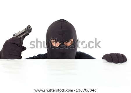 Thief capped with a pistol and the white bottom - stock photo