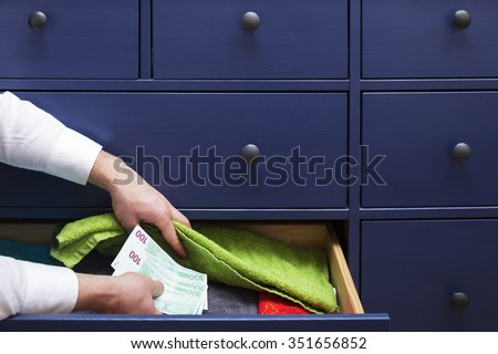 thief found a stash at home robbery - stock photo