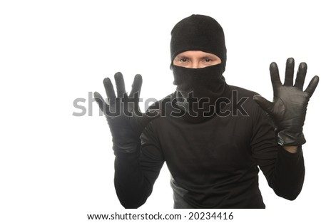 thief has lifted hands upwards on the isolated background - stock photo