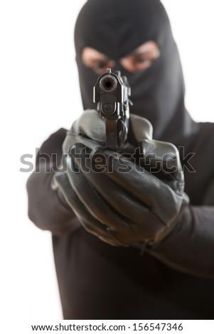 Thief holding a gun on a white background - stock photo