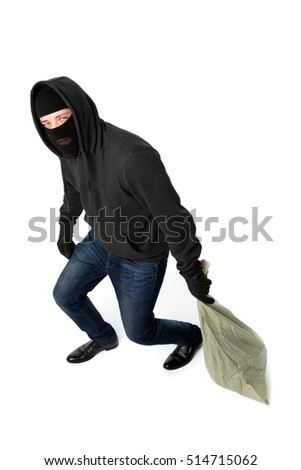 Thief in gloves carries bag