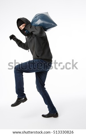 Thief in gloves with bag