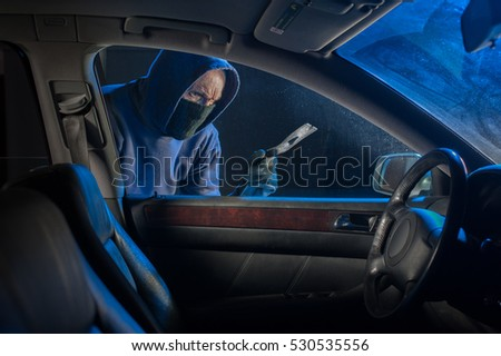 Thief looking to steal a car or objects inside