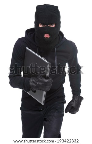 Thief stealing a laptop computer. Isolated on white background - stock photo