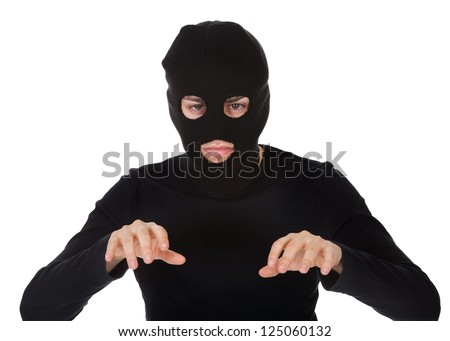 Thief wearing a balaclava dressed in blacked moving stealthily. Isolated on white - stock photo