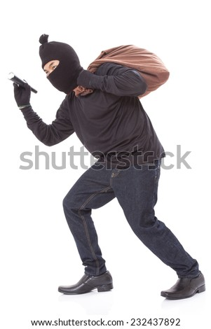 Thief with bag and holding flashlight, isolated on white background  - stock photo