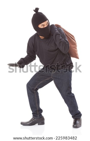 Thief with bag and holding knife, isolated on white background