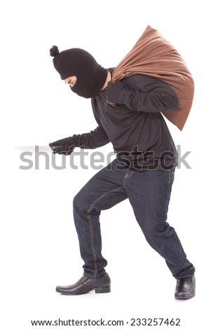 Thief with bag and holding knife, isolated on white background  - stock photo