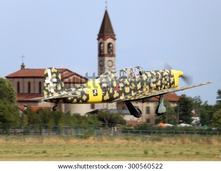 Thiene, Vicenza - Italy. 26th July, 2015: important air show called FlighThiene in Thiene Airport. Military plane with camouflage colors perform amazing aerial stunts.