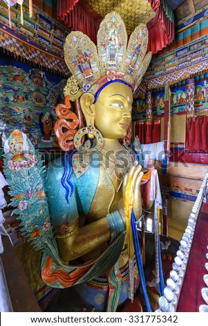 Thikse, India - August 16, 2015: View of the huge staute depicting Maitreya in Thikse Monastery. Maitreya is regarded as a future Buddha of this world in Buddhist eschatology. - stock photo